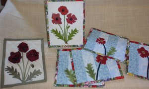 Mug mats and decortaor items with poppy applique.