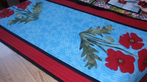 A beautiful poppy table runner by Fay.